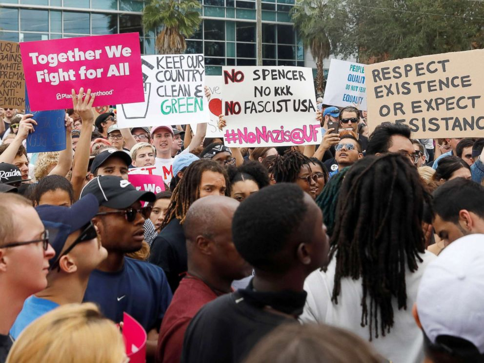 PHOTO: Demonstrators rally before the speech by Richard Spencer, an avowed white nationalist and spokesperson for the so-called alt-right movement, on the campus of the University of Florida in Gainesville, Florida, Oct. 19, 2017.
