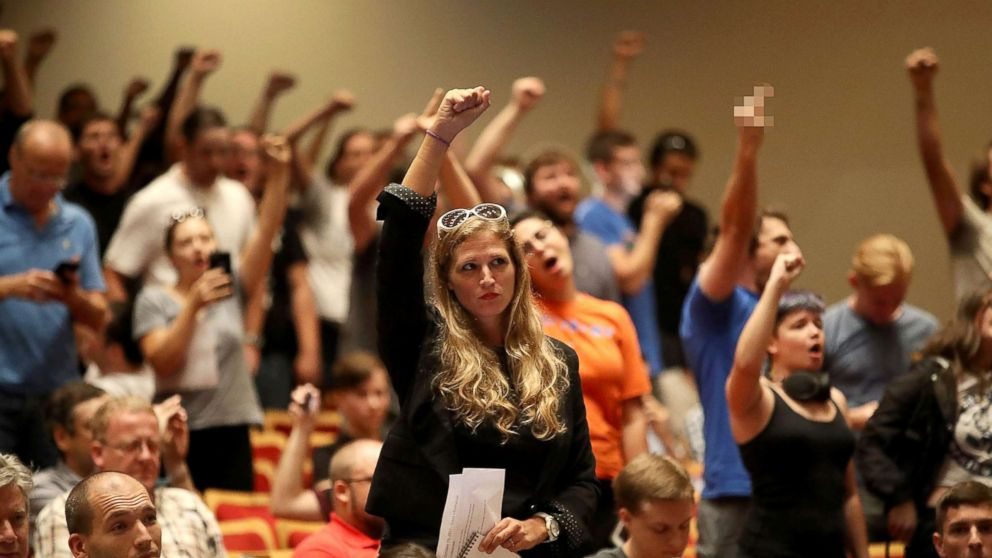 """People react as white nationalist Richard Spencer, who popularized the term """"alt-right"""" speaks at the Curtis M. Phillips Center for the Performing Arts, Oct. 19, 2017, in Gainesville, Florida."""