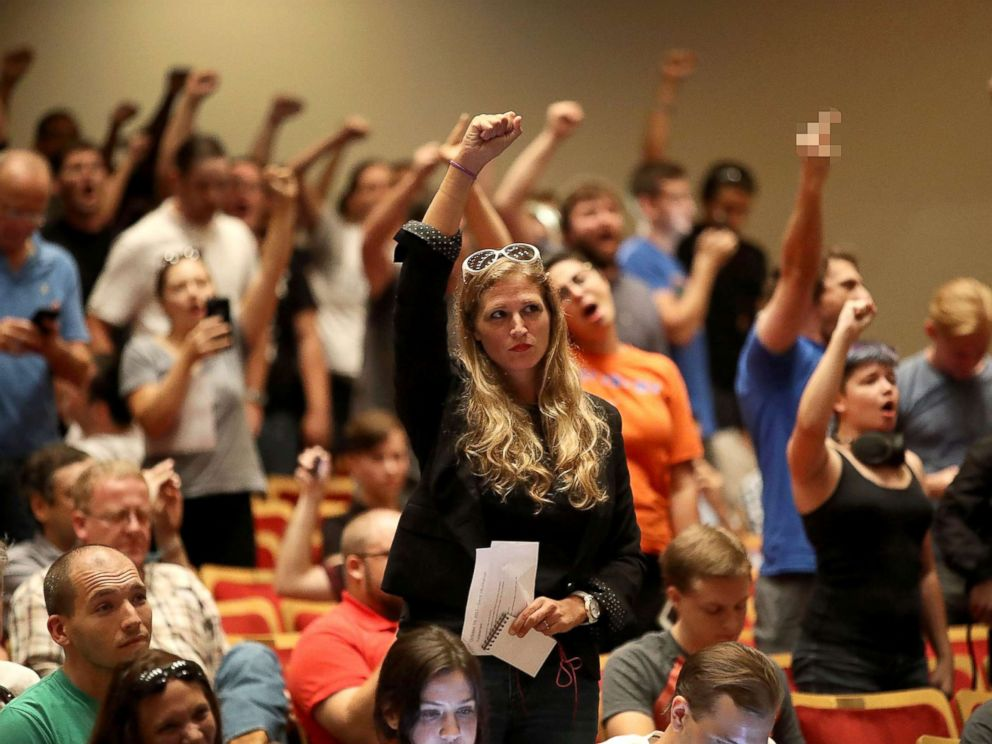 PHOTO: People react as white nationalist Richard Spencer, who popularized the term alt-right speaks at the Curtis M. Phillips Center for the Performing Arts, Oct. 19, 2017, in Gainesville, Florida.