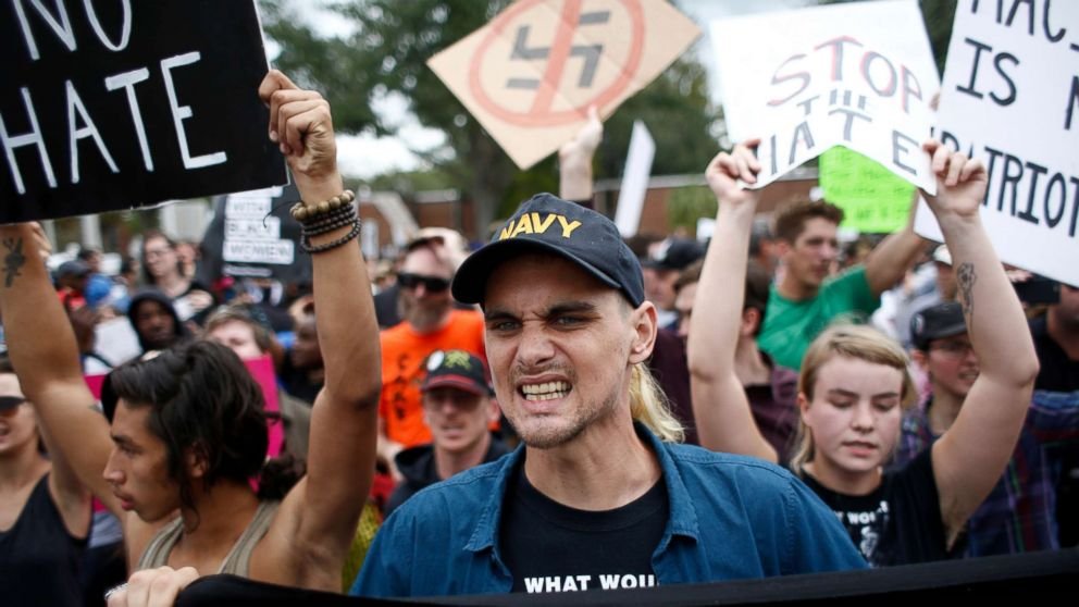 Demonstrators gather at the site of a planned speech by white nationalist Richard Spencer, who popularized the term 'alt-right', at the University of Florida campus, Oct. 19, 2017, in Gainesville, Florida.