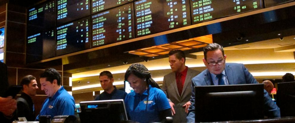 PHOTO: This Oct. 25, 2018 photo shows employees at the new sports book at the Tropicana casino in Atlantic City N.J., preparing to take bets moments before it opened.