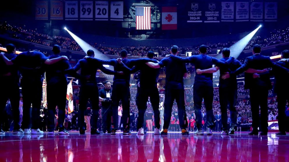 The Utah Jazz stand together during the national anthem prior to Game Seven of the Western Conference Quarterfinals against the Los Angeles Clippers at the Staples Center, April 30, 2017, in Los Angeles.