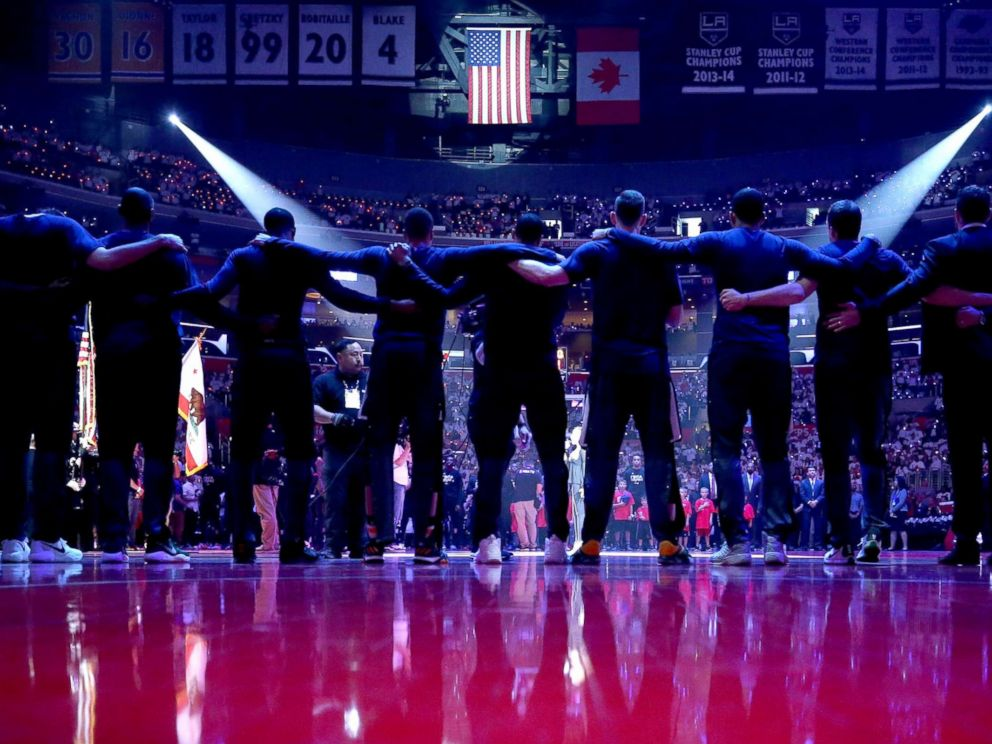 PHOTO: The Utah Jazz stand together during the national anthem prior to Game Seven of the Western Conference Quarterfinals against the Los Angeles Clippers at the Staples Center, April 30, 2017, in Los Angeles.