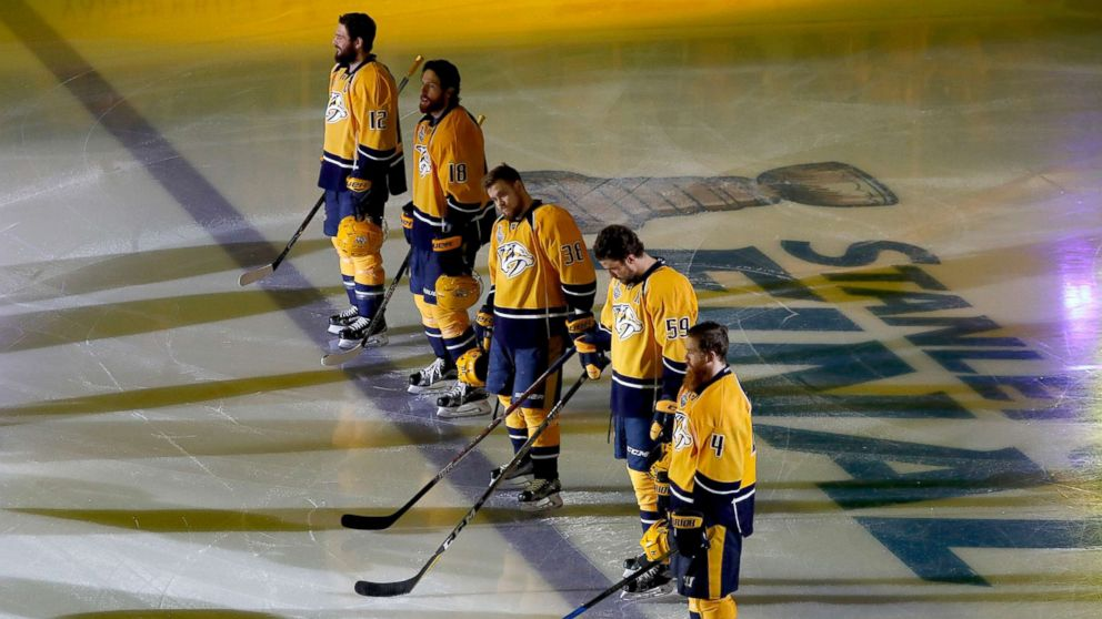 Nashville Predators players stand on the ice during the national anthem prior to Game Three of the 2017 NHL Stanley Cup Final against the Pittsburgh Penguins at the Bridgestone Arena, June 3, 2017, in Nashville.