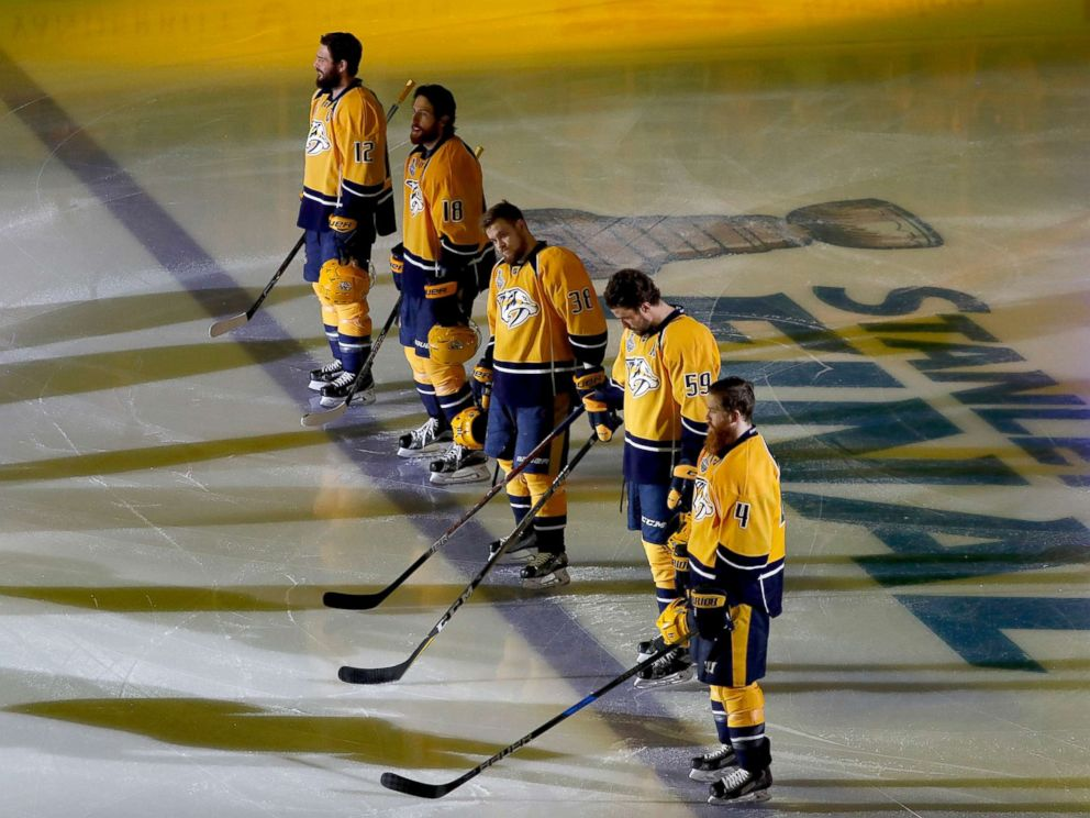PHOTO: Nashville Predators players stand on the ice during the national anthem prior to Game Three of the 2017 NHL Stanley Cup Final against the Pittsburgh Penguins at the Bridgestone Arena, June 3, 2017, in Nashville.