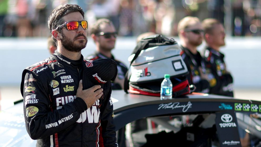 Martin Truex Jr.stands during the national anthem prior to the Monster Energy NASCAR Cup Series ISM Connect 300 at New Hampshire Motor Speedway, Sept. 24, 2017, in Loudon, New Hampshire.