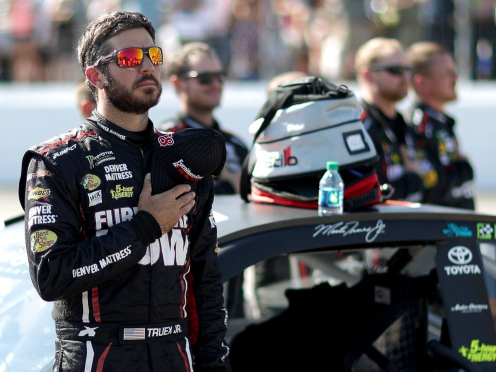 PHOTO: Martin Truex Jr.stands during the national anthem prior to the Monster Energy NASCAR Cup Series ISM Connect 300 at New Hampshire Motor Speedway, Sept. 24, 2017, in Loudon, New Hampshire.