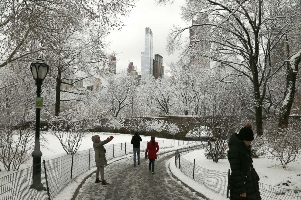 PHOTO: New Yorkers enjoy the morning snow in Central Park after an early spring storm on April 2, 2018 in New York.