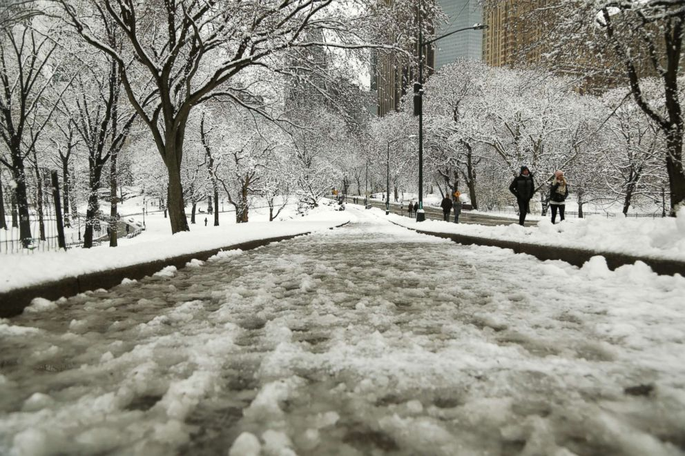 PHOTO:Slush and ice coat the pathways in Central Park after an early spring storm on April 2, 2018 in New York.
