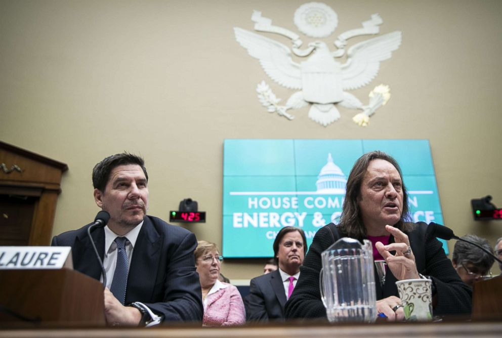 PHOTO: John Legere, chief executive officer of T-Mobile US Inc., right, speaks as Marcelo Claure, chairman of Sprint Corp, listens during a hearing on the the T-Mobile and Sprint merger on Capitol Hill, Feb. 13, 2019.