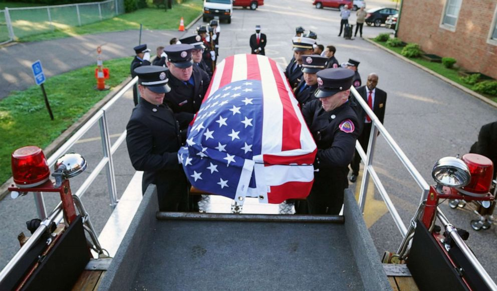 PHOTO: St. Louis Firefighters load the casket of firefighter Rodney Heard, Sr. onto a parade pumper for a memorial service in St. Louis on Monday, June 28, 2021. Heard died in the line of duty from complications due to COVID-19 on June 15, 2021.