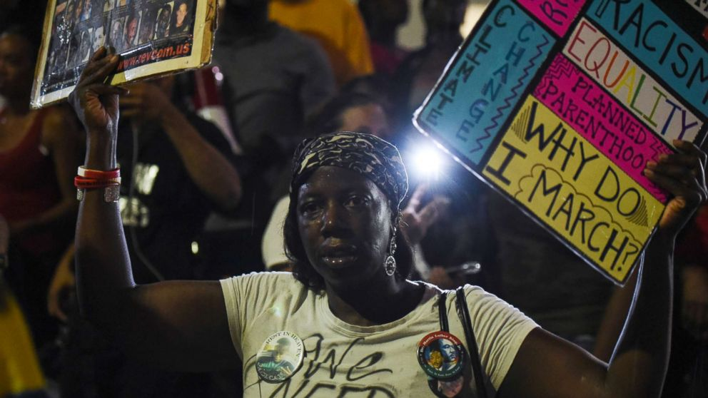 A woman joins demonstrators outside the St. Louis Justice Center following multiple arrests, Sept. 17, protesting the acquittal of former St. Louis police officer Jason Stockley, Sept. 18, 2017, in St. Louis, Mo.