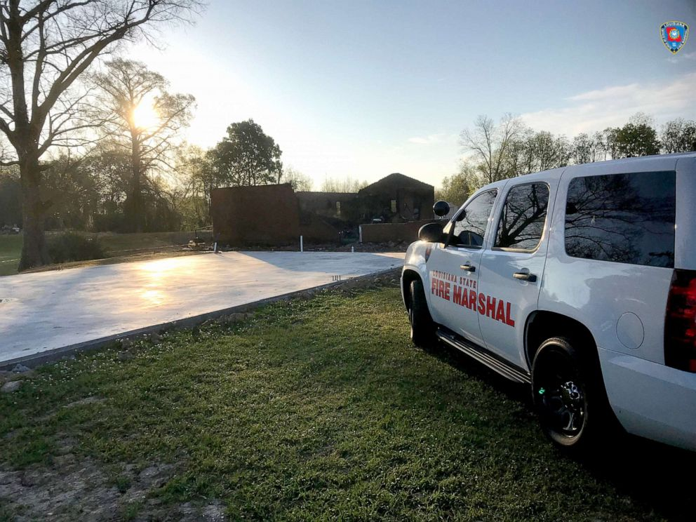 A Louisiana State Fire Marshall vehicle is seen outside the fire-destroyed St. Mary Baptist Church in Port Barre, Louisiana, March 26, 2019, in this picture obtained from social media.