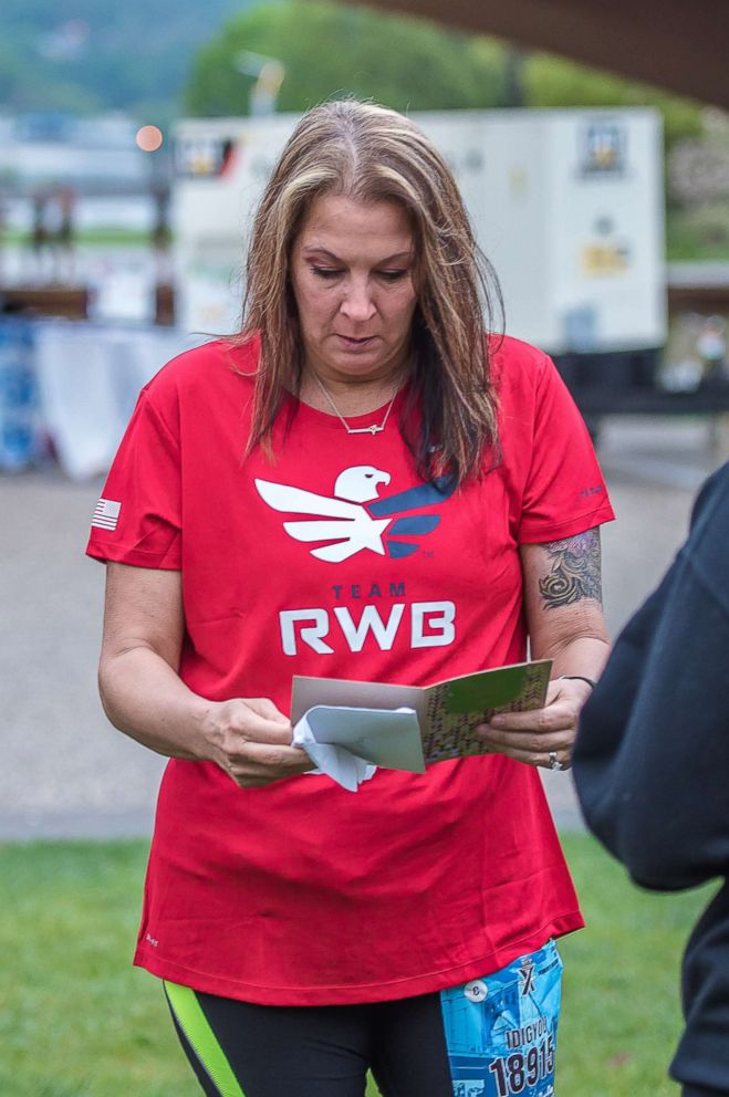 PHOTO: Stacey Faix reads card her biological son wrote to her before she looks up and sees him.