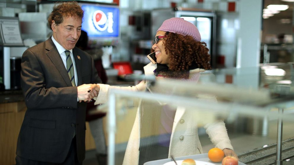 Rep. Jamie Raskin greets Consumer Product Safety Commission employee Stacy Summerville as she gathered her lunch in the cafeteria at the Tommy Douglas Conference Center, Jan. 14, 2019, in Silver Spring, Maryland.