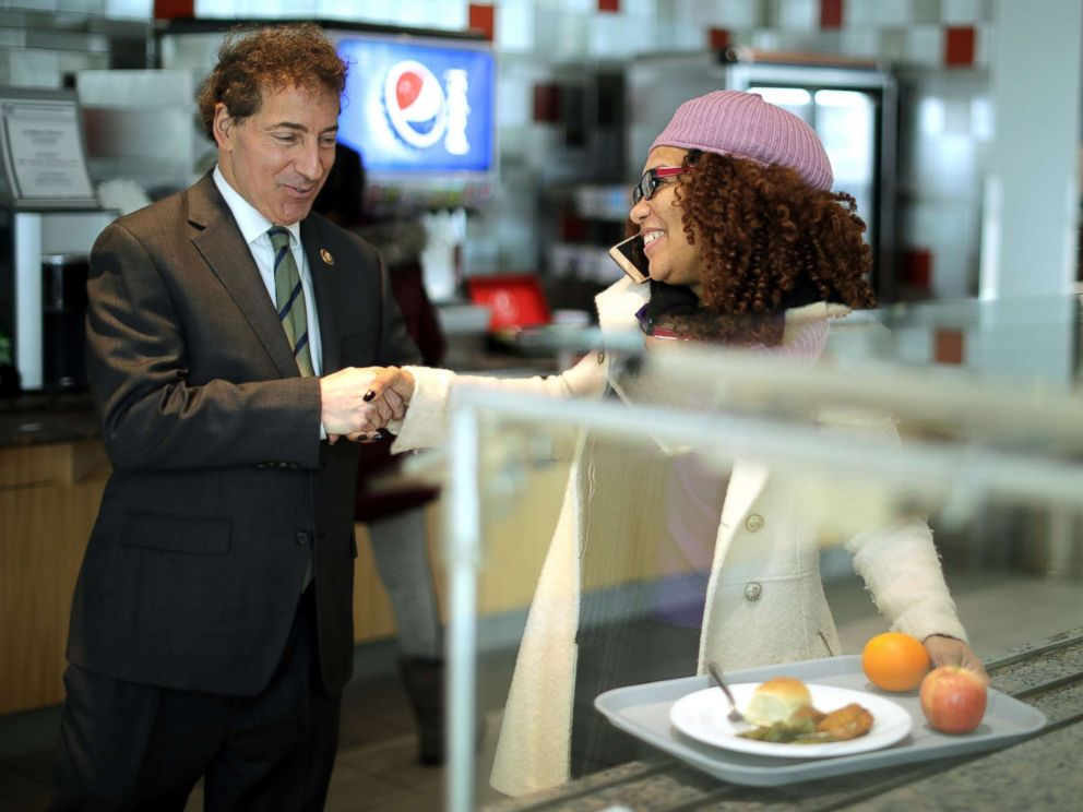PHOTO: Rep. Jamie Raskin greets Consumer Product Safety Commission employee Stacy Summerville as she gathered her lunch in the cafeteria at the Tommy Douglas Conference Center, Jan. 14, 2019, in Silver Spring, Maryland.