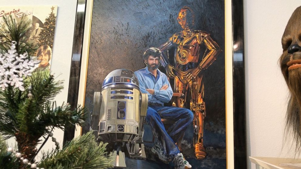 PHOTO: A fan-made painting of Star Wars creator George Lucas along with droids C-3PO and R2-D2 hangs on the wall at Rancho Obi Wan.