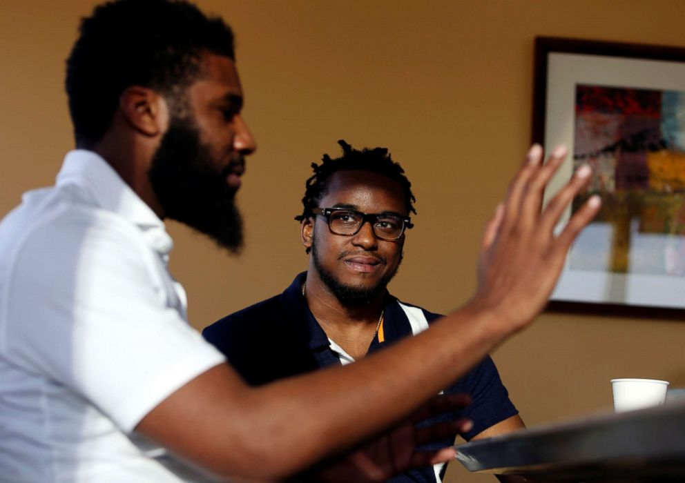 PHOTO: Rashon Nelson, left, and Donte Robinson are interviewed by The Associated Press in Philadelphia.  Starbucks closing 8,000 stores today to give employees classes in rooting out racial bias Starbucks closing 8,000 stores today to give employees classes in rooting out racial bias starbucks interview ap ml 180419 hpEmbed 17x12 992