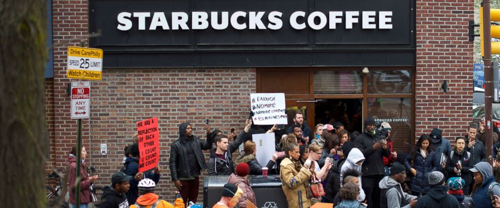 PHOTO: Protesters demonstrate outside a Center City Starbucks, April 15, 2018 in Philadelphia.
