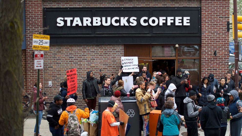 Protesters demonstrate outside a Center City Starbucks, April 15, 2018 in Philadelphia. Police arrested two black men who were waiting inside the Center City Starbucks which prompted an apology from the company's CEO.