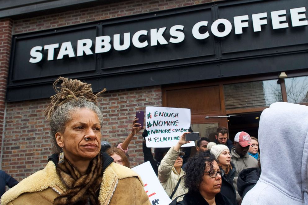 Michelle Brown, 50, left, demonstrates outside a Center City Starbucks, April 15, 2018 in Philadelphia. Police arrested two black men who were waiting inside the Center City Starbucks which prompted an apology from the company's CEO.