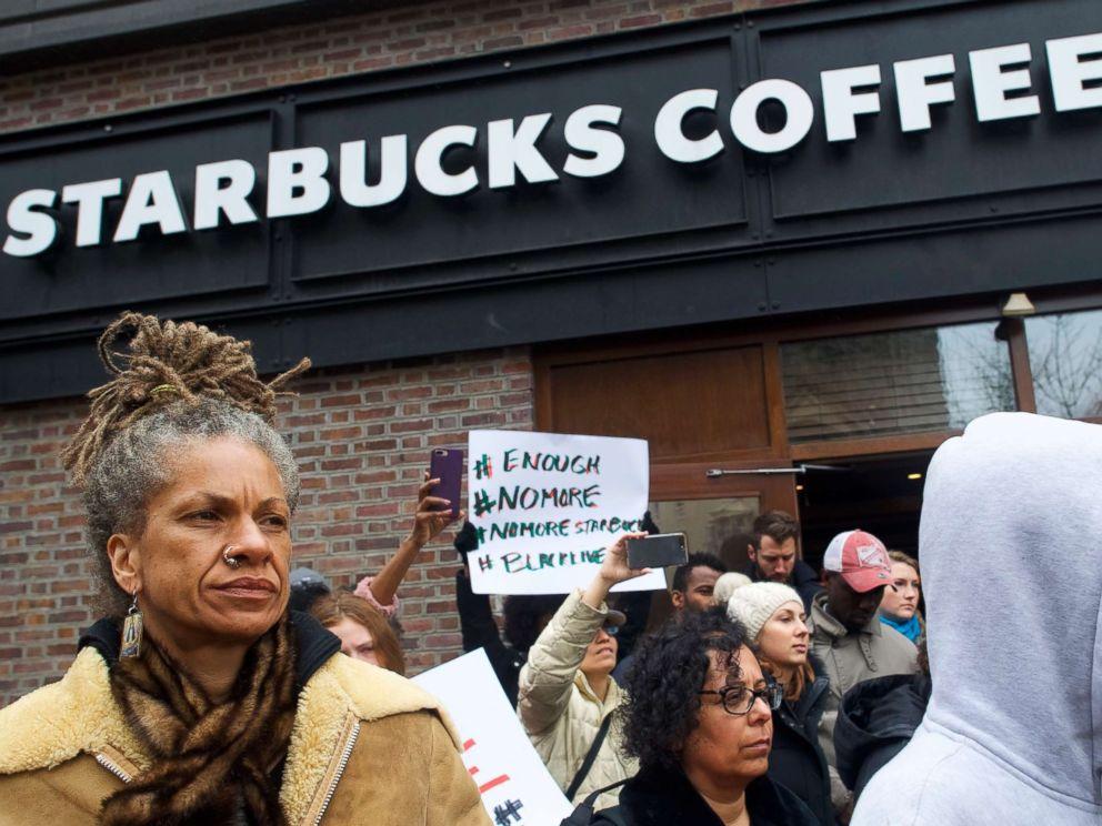PHOTO: Michelle Brown, 50, left, demonstrates outside a Center City Starbucks, April 15, 2018, in Philadelphia.