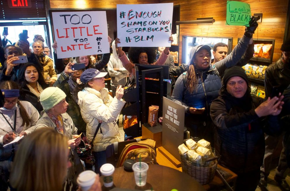 People demonstrate inside a Center City Starbucks, April 15, 2018 in Philadelphia. Police arrested two black men who were waiting inside the Center City Starbucks which prompted an apology from the company's CEO.