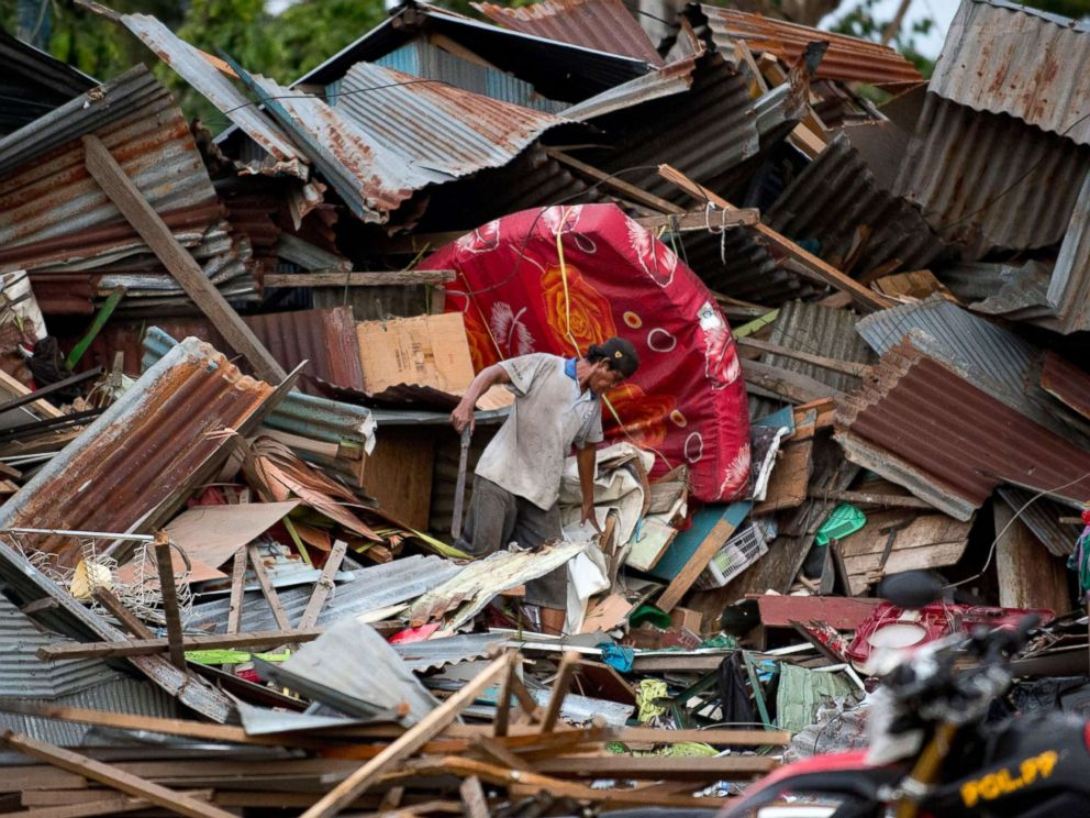 PHOTO: A man looks for his belongings amid the debris of his destroyed house in Palu in Central Sulawesi on Sept. 29, 2018, after a strong earthquake and tsunami struck the area.