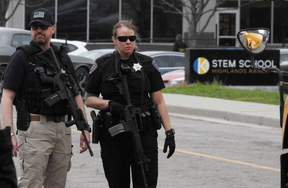 PHOTO: Officers stand guard in front of STEM School Highlands Ranch after a shooting, May 7, 2019, in Highlands Ranch, Colo.