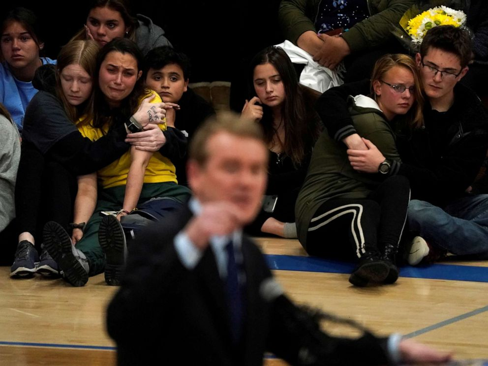 PHOTO: Students hug at a vigil for the victims of the shooting at the STEM School in Highlands Ranch, Colo., May 8, 2019, as Sen. Michael Bennett speaks.