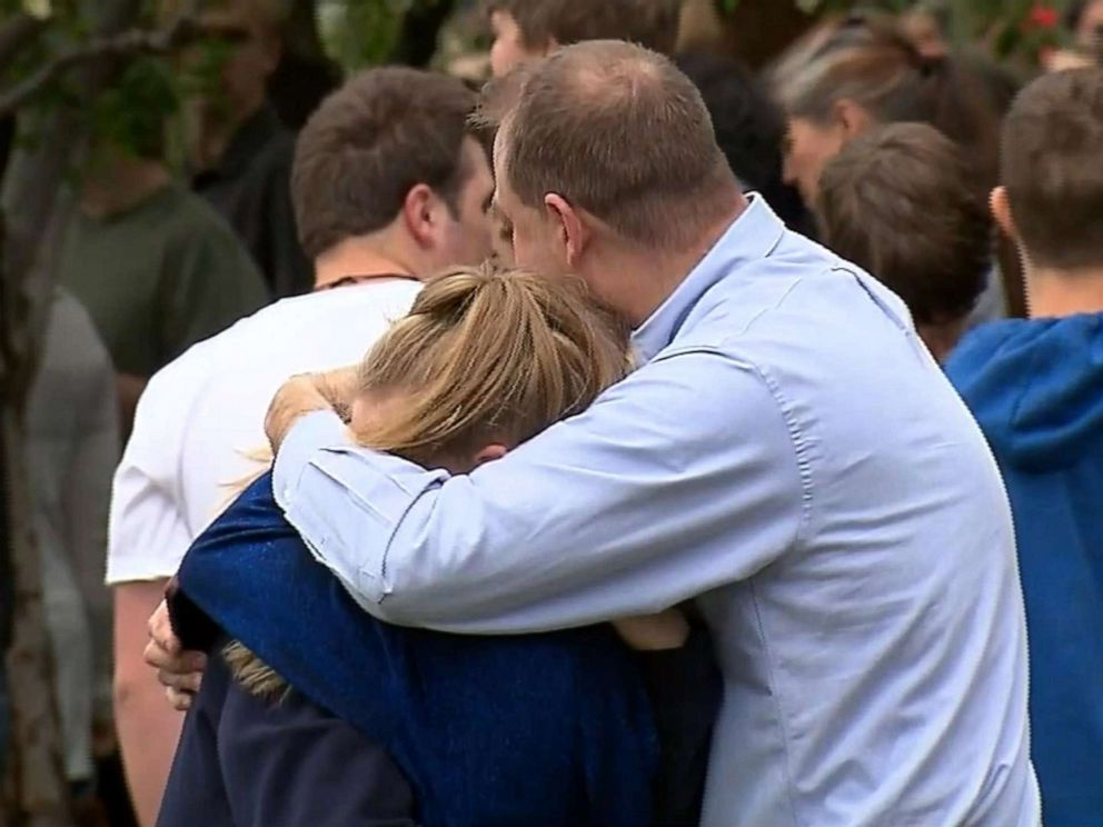 PHOTO: People hug at a meetup area after reports of a shooting at STEM School Highlands Ranch in Highlands Ranch, Colo., May 7, 2019.