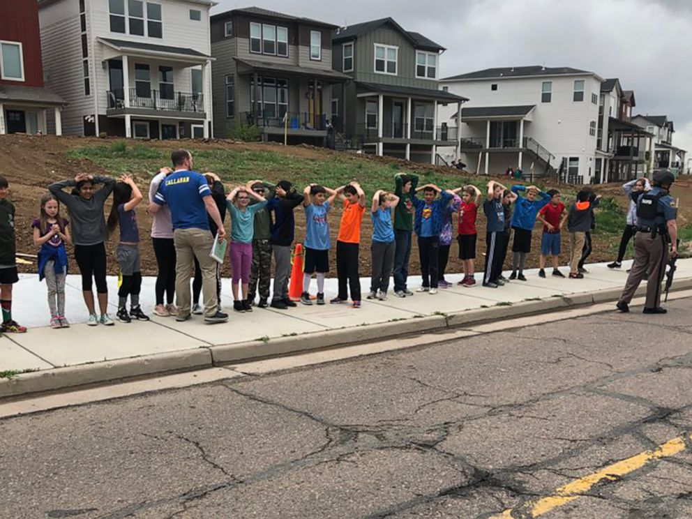 PHOTO: Children stand with their hands on their heads in a photo shared on social media after a shooting at STEM School Highlands Ranch in Highlands Ranch, Colo., May 7, 2019.