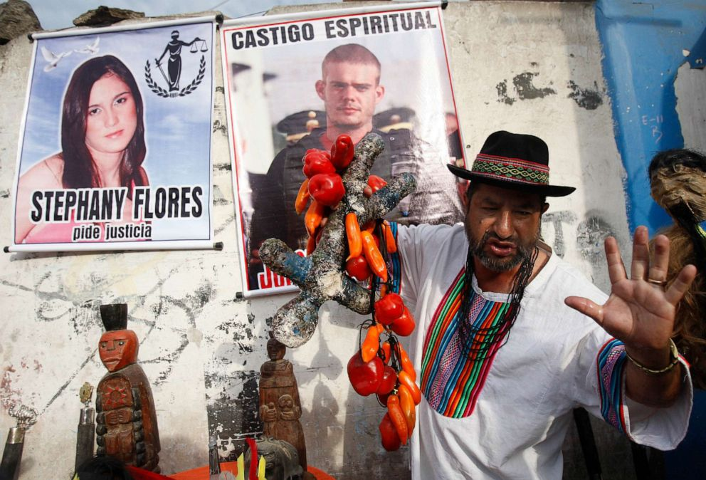 PHOTO: A shaman performs a ritual for the spiritual punishment of Joran van der Sloot, in poster top center, and for justice for Stephany Flores, in poster at left, in Lima, Peru, Jan. 6, 2012.