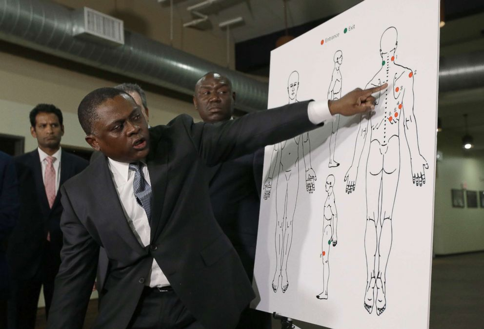 PHOTO: Pathologist, Dr. Bennet Omalu, gestures to a diagram showing the gun shot wounds he found on the body of police shooting victim Stephon Clark, during a news conference, March 30, 2018, in Sacramento, Calif.