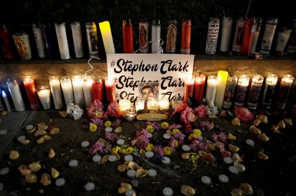 Candles light a sidewalk memorial to Stephon Clark, in Sacramento, Calif., March 23, 2018.