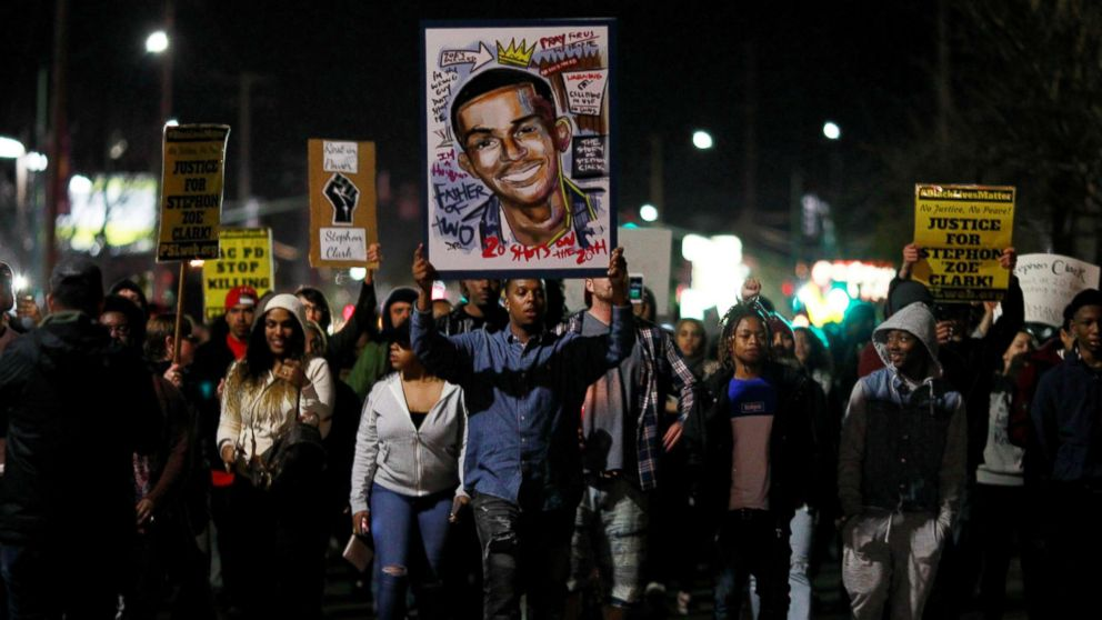Demonstrators march to protest the police shooting of Stephon Clark, in Sacramento, Calif., March 23, 2018.