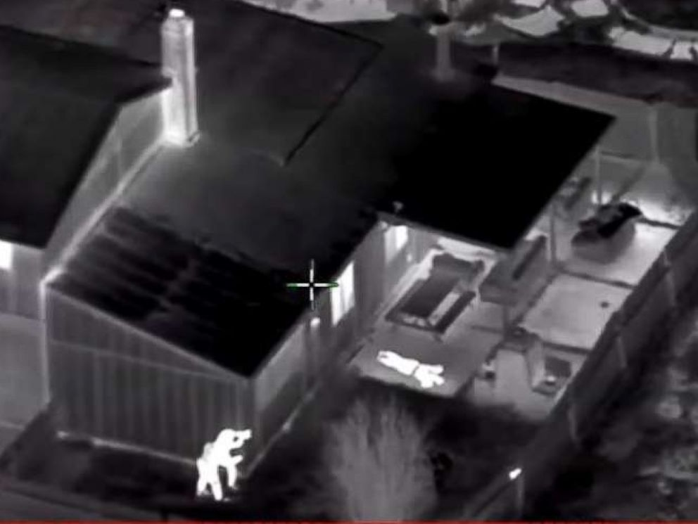 PHOTO: In this screen grab taken from police helicopter camera video released by the Sacramento Police Department, police are seen shooting at Stephon Clark in the backyard of his grandmothers house on March 18, 2018.