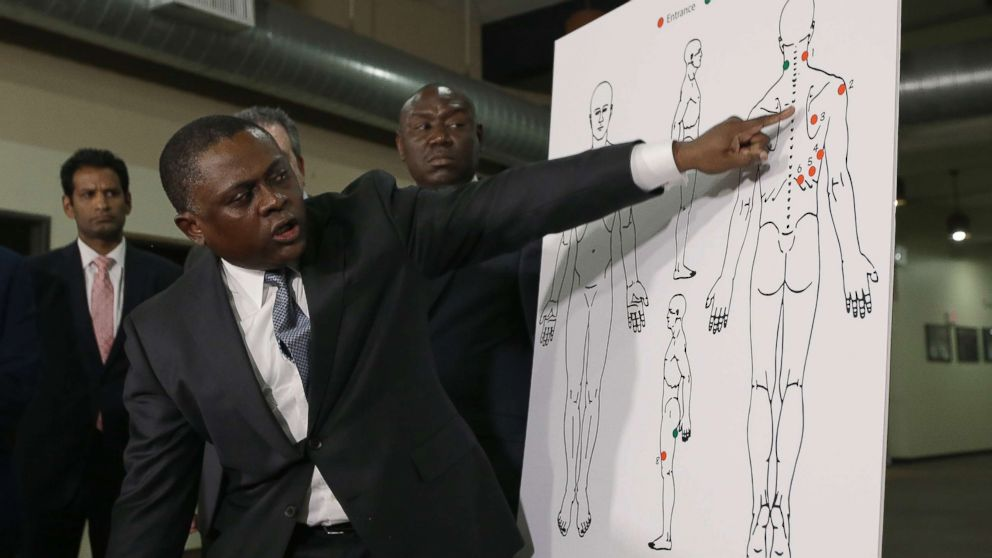 Pathologist, Dr. Bennet Omalu, gestures to a diagram showing the gun shot wounds he found on the body of police shooting victim Stephon Clark, during a news conference Friday, March 30, 2018, in Sacramento, Calif.