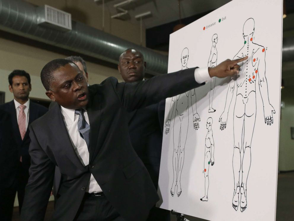 PHOTO: Pathologist, Dr. Bennet Omalu, gestures to a diagram showing the gun shot wounds he found on the body of police shooting victim Stephon Clark, during a news conference Friday, March 30, 2018, in Sacramento, Calif.