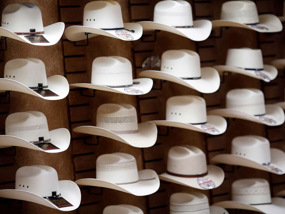PHOTO: Stetson brand cowboy hats are displayed on a wall inside the showroom of the Hatco Inc. manufacturing facility in Garland, Texas, Aug. 28, 2015.