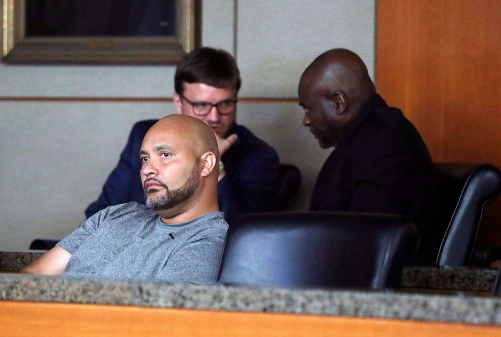 PHOTO: Former Houston police officers Steven Bryant, foreground, and Gerald Goines, background, turn themselves in at the Civil Courthouse, Friday, August 23, 2019, in Houston.