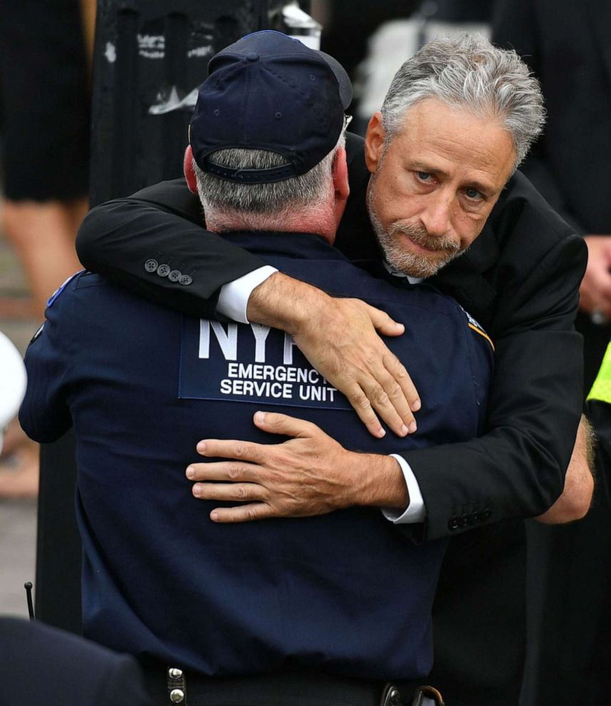PHOTO: Jon Stewart hugs another attendee during funeral services for 9/11 first responder Luis Alvarez in New York City, July 3, 2019.