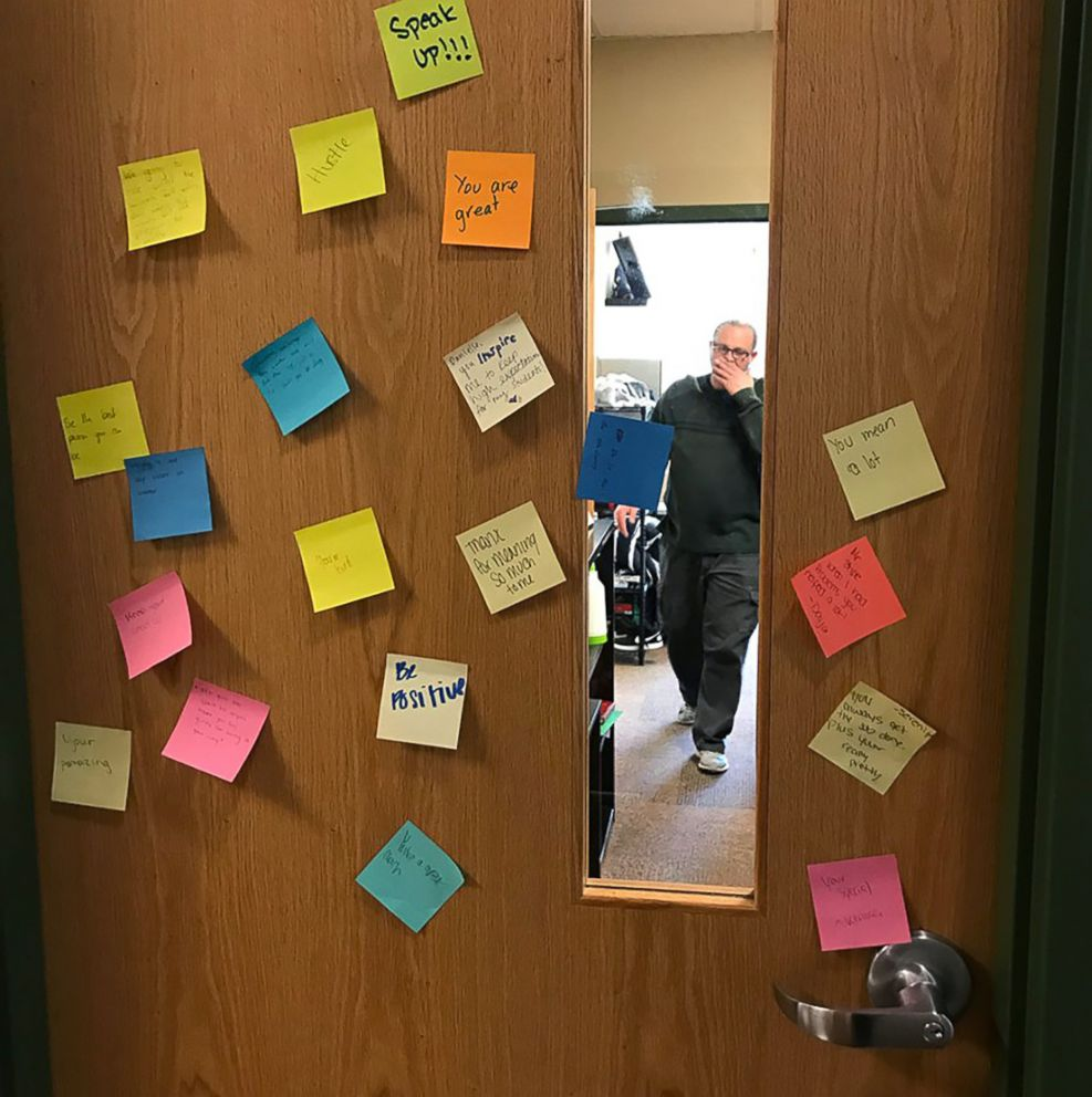 PHOTO: A door at Arbor Preparatory High School in Michigan covered with post-it notes that had words of love and encouragement.