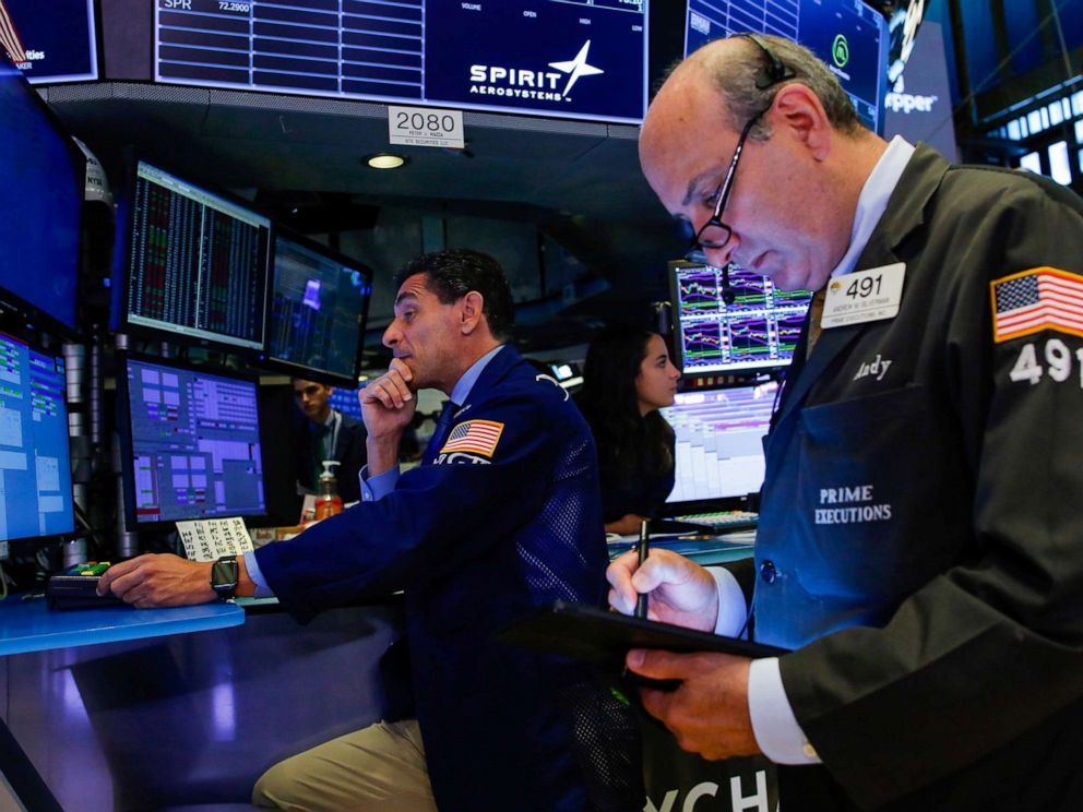 PHOTO: Traders work on the floor at the New York Stock Exchange (NYSE) in New York, August 13, 2019.