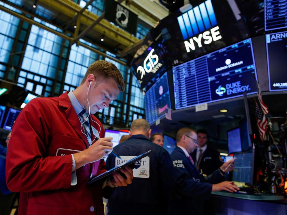 PHOTO: Traders work on the floor at the New York Stock Exchange in New York, August 13, 2019.