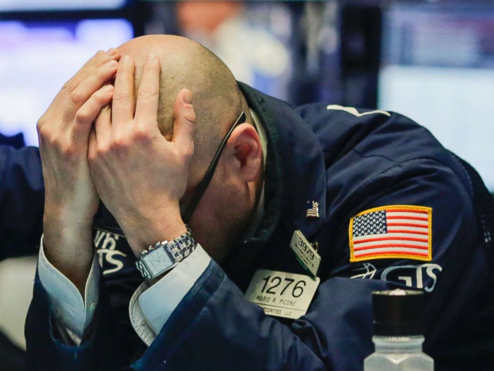 A trader reacts on the floor of the New York Stock Exchange (NYSE) on March 1, 2018, in New York City. Major stock indexes plunged following President Trumps announcement he was imposing a 25 percent tariff on imported steel and 10 percent on aluminum.