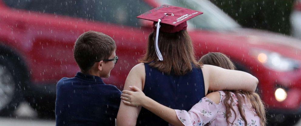 PHOTO: People leave a graduation ceremony for Marjory Stoneman Douglas seniors, June 3, 2018, in Sunrise, Fla.