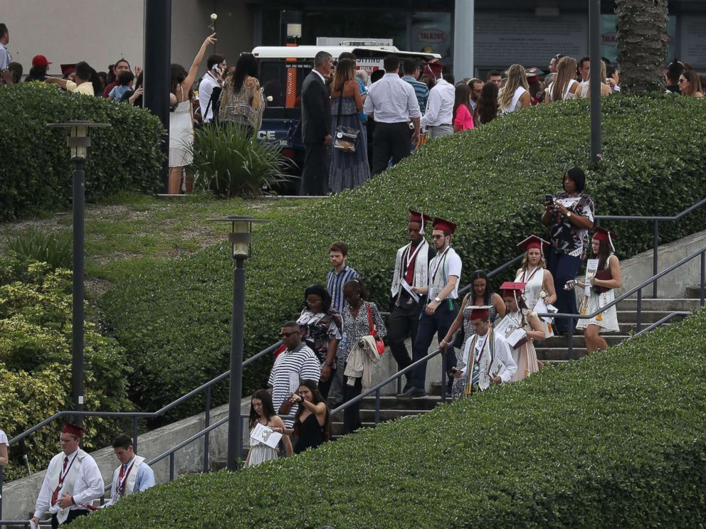 PHOTO: Graduates of Marjory Stoneman Douglas High School are seen as they head to their cars after attending their graduation ceremony at the BB&T Center on June 3, 2018, in Sunrise, Florida.