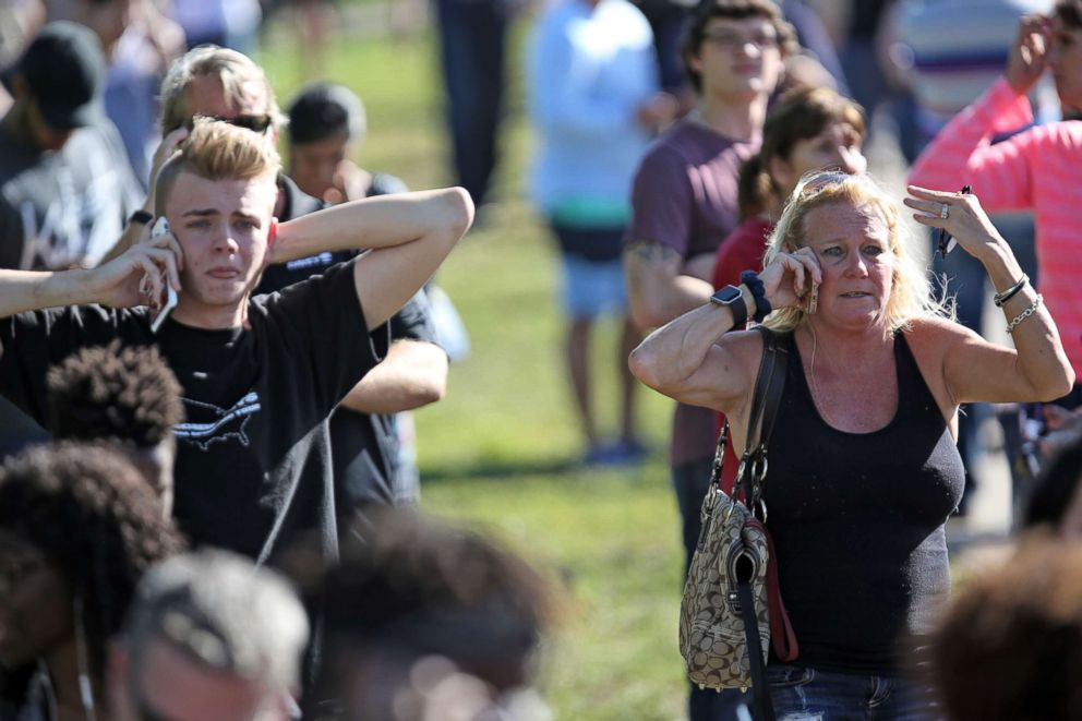 PHOTO: Waiting for word from students at Coral Springs Drive and the Sawgrass Expressway just south of the campus of Stoneman Douglas High School in Parkland, Fla., after a shooting on Feb. 14, 2018.