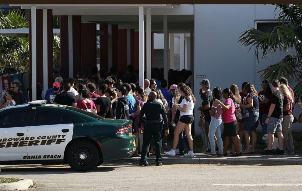 PHOTO: People visit Marjory Stoneman Douglas High School campus on Feb. 25, 2018 in Parkland, Fla. for the first time since the shooting that killed 17 people on Feb. 14.